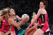 Liz Watson of the Vixens and Kate Shimmin of the Thunderbirds compete for the ball during the round 11 Super Netball match between the Vixens and the Thunderbirds at Hisense Arena on July 15, 2018 in Melbourne, Australia.