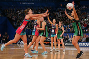 Liz Watson of the Vixens passes the ball against Verity Charles of the Fever during the round 13 Super Netball match between the Fever and the Vixens at Perth Arena on July 28, 2018 in Perth, Australia.