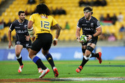Marcell Coetzee of the Sharks runs at Ma'a Nonu of the Hurricanes during the round 13 Super Rugby match between the Hurricanes and the Sharks at Westpac Stadium on May 9, 2015 in Wellington, New Zealand.