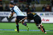 Israel Folau of the Waratahs is caught by Liam Messam of the Chiefs during the round 15 Super Rugby match between the Chiefs and the Waratahs at Waikato Stadium on June 3, 2017 in Hamilton, New Zealand.