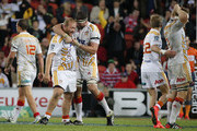 (L-R) Jarrod Firth and Michael Fitzgerald of the Chiefs celebrate their win during round 17 Super Rugby match between the Reds and the Chiefs at Suncorp Stadium on June 6, 2015 in Brisbane, Australia.