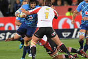 Jacques Potgieter of the Bulls is tackled by JC Janse van Rensburg of the Lions during the Super Rugby match between Vodacom Bulls and MTN Lions at Loftus Versfeld on July 14, 2012 in Pretoria, South Africa.