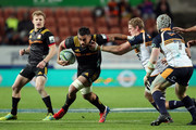Chiefs Liam Messam is tackled during the round 18 Super Rugby match between the Chiefs and the Brumbies at FMG Stadium Waikato on July 7, 2018 in Hamilton, New Zealand.