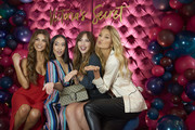 """Negin Mirsalehi (L) and Romee Strijd pose for a photo with guests at Hotel Crescent while celebrating the all new """"Body by Victoria"""" collection on August 14, 2018 in Dallas, Texas."""