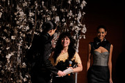 Model Coca Rocha presents the award for the Woman's Eveningwear section of the Supima Design Competitionan to Gina Desilva at The New York Times Center on January 19, 2010 in New York City.