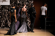 Models wearing Gina Desilva are led offstage by model Coca Rocha after Gina Desilva was named winner of the Woman's Eveningwear section of the Supima Design Competition during the Supima Design Competition at The New York Times Center on January 19, 2010 in New York City.