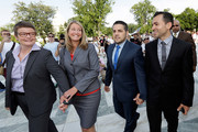 (L to R) Plaintiff couples Sandy Stier and Kris Perry and Jeff Zarillo and Paul Katami arrive at the U.S. Supreme Court building June 26, 2013 in Washington, DC. The high court ruled to strike down DOMA and determined the California's proposition 8 ban on same-sex marriage was not properly before them, declining to overturn the lower court's striking down of the law.