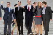 Members of the plaintiff team in the same sex marriage cases before the Supreme Court (L-R) plaintiff Paul Katami, plaintiff Jeff Zarillo, attorney David Boies, plaintiff Kris Perry and plaintiff Sandy Stier wave from the court's steps after favorable rulings were issued June 26, 2013 in Washington, DC. The high court ruled to strike down DOMA and determined the California's proposition 8 ban on same-sex marriage was not properly before them, declining to overturn the lower court's striking down of the law.