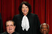 Associate Justice Sonia Sotomayor (C) is flanked by Associate Justice Antonin Scalia (L) and Associate Justice Clarence Thomas (R) while taking a group photograph at the Supreme Court building on September 29, 2009 in Washington, DC. Justice Sonia Sotomayor is the newsest edition to the high court.