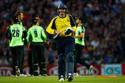 Dominic Cork of Hampshire walks off after being bowled during the Friends Life T20 match between Surrey and Hampshire at The Kia Oval on July 8, 2011 in London, England.