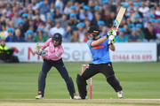 Luke Wright of Sussex hits out with wicketkeeper John Simpson of Middlesex during the Vitality Blast match between Sussex Sharks and Middlesex at The 1st Central County Ground on August 17, 2018 in Hove, England.