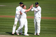 Essex's Graham Napier celebrates with Jesse Ryder (R) after taking the wicket of Sussex's Ross Taylor during day one of the Specsavers County Championship Division Two match between Sussex and Essex at The 1st Central County Ground, on April 17, 2016 in Hove, England.