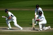 John Simpson of Middlesex hits out while Ben Brown and Phillip Salt of Sussex look on during day three of the Specsavers County Championship: Division Two match between Sussex and Middlesex at The 1st Central County Ground on May 6, 2018 in Hove, England.