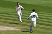 Hilton Cartwright of Middlesex celebrates with wicketkeeper John Simpson after catching Luke Wright of Sussex first ball off his own bowling during the Specsavers County Championship Division Two match between Sussex and Middlesex at The 1st Central County Ground on May 7, 2018 in Hove, England.