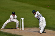 Alexei Kervezee of Gloucestershire hits a six as wicketkeeper Ben Brown of Sussex looks on during the LV County Championship match between Sussex and Gloucestershire at BrightonandHoveJobs.com County Ground on April 20, 2015 in Hove, England.