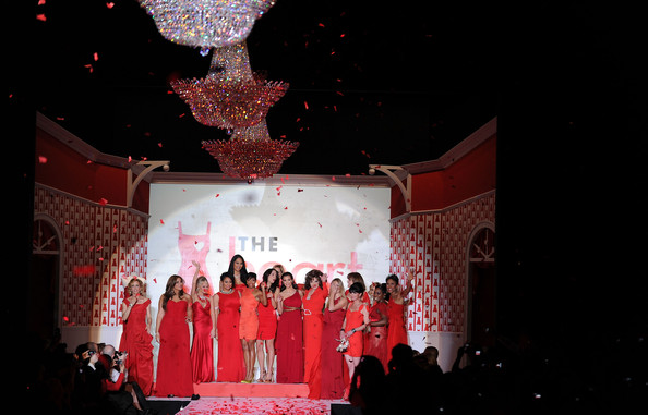 (L-R) Actress Felicity Huffman, singer Jordin Sparks, actresses Kristin Chenoweth, Raven-Symone, Kimora Lee, TV personality Bethenny Frankel, actress Regina King, Dara Torres, Kim Kardashian, actress Joan Collins, Heidi Klum, actresses Valerie Harper, Pauley Perrette, Elisabeth Hasselbeck, singer Estelle, and TV personality Robin Roberts walk the runway during Swarovski at the Red Dress Collection 2010 Fashion Show during Mercedes-Benz Fashion Week at The Tent at Bryant Park on February 11, 2010 in New York City.