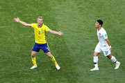 Sebastian Larsson of Sweden and Hwang Hee-chan of Korea Republic react during the 2018 FIFA World Cup Russia group F match between Sweden and Korea Republic at Nizhniy Novgorod Stadium on June 18, 2018 in Nizhniy Novgorod, Russia.
