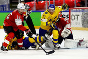 Patric Hornqvist #72 of Sweden and Raphael Diaz #16 of Switzerland battle for the puck during the 2018 IIHF Ice Hockey World Championship Gold Medal Game game between Sweden and Switzerland at Royal Arena on May 20, 2018 in Copenhagen, Denmark.