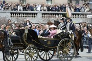 Sweden's Queen Silvia and King Carl XVI Gustaf leave the Royal Palace in an open carriage for the lunch hosted by the City of Stockholm at the City Hall for king Carl XVI Gustaf on his birthday, on April 30, 2016.. / AFP / TT NEWS AGENCY AND TT News Agency / Jessica Gow / Sweden OUT