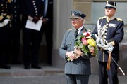 King Carl XVI Gustaf of Sweden poses with flowers and gifts he received at a celebration of his 73rd birthday anniversary at the Royal Palace  on April 30, 2019 in Stockholm, Sweden.