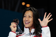 Bronze medal winner Aya Terakawa of Japan celebrates on the podium after the Swimming Women's Backstroke 50m Final on day thirteen of the 15th FINA World Championships at Palau Sant Jordi on August 1, 2013 in Barcelona, Spain.