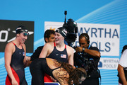 Natalie Coughlin (C), Shannon Vreeland (L) Missy Franklin (R) and Megan Romano (in water) of the USA celebrate after the Swimming Women's4x100mFreestyle on day nine of the 15th FINA World Championships at Palau Sant Jordi on July 28, 2013 in Barcelona, Spain.