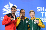 (L-R) Silver medalist Dylan Carter of Trinidad and Tobago, gold medalist Chad le Clos of South Africa  and bronze medalist Ryan Coetzee of South Africa pose during the medal ceremony for the Men's 50m Butterfly Final on day two of the Gold Coast 2018 Commonwealth Games at Optus Aquatic Centre on April 6, 2018 on the Gold Coast, Australia.