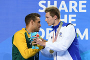 Gold medalist Duncan Scott of Scotland (R) and silver medalist Chad le Clos of South Africa embrace during the medal ceremony for the Men's 100m Freestyle Final on day four of the Gold Coast 2018 Commonwealth Games at Optus Aquatic Centre on April 8, 2018 on the Gold Coast, Australia.