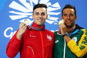 (L-R) Silver medalist James Guy of England and gold medalist Chad le Clos of South Africa pose during the medal ceremony for the Men's 100m Butterfly Final on day five of the Gold Coast 2018 Commonwealth Games at Optus Aquatic Centre on April 9, 2018 on the Gold Coast, Australia.