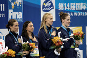 (L-R) Natalie Coughlin, Rebecca Soni, Dana Vollmer and Melissa Franklin of the United States pose with their gold medals in the Women's 4x100m Medley Relay during Day Fifteen of the 14th FINA World Championships at the Oriental Sports Center on July 30, 2011 in Shanghai, China.