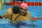 Silver medalist Yuliya Efimova (R) of Russia celebrates with gold medalist  Rebecca Soni of the United States after the Women's 200m Breaststroke Final during Day Fourteen of the 14th FINA World Championships at the Oriental Sports Center on July 29, 2011 in Shanghai, China.
