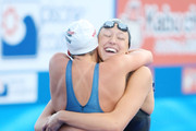 Rebecca Soni (blue) and Kasey Carlson of the United States hug and celebrate coming first and third respectively in the Women's 100m Breaststroke Final during the 13th FINA World Championships at the Stadio del Nuoto on July 28, 2009 in Rome, Italy.