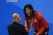 Gold medalist Rie Kaneto of Japan is presented her medal on the podium during the medal ceremony for the Women's 200m Breaststroke Final on Day 6 of the Rio 2016 Olympic Games at the Olympic Aquatics Stadium on August 11, 2016 in Rio de Janeiro, Brazil.