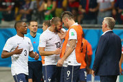Karim Benzema of France (2nd L) celebrates scoring his team's fourth goal with Olivier Giroud during the 2014 FIFA World Cup Brazil Group E match between Switzerland and France at Arena Fonte Nova on June 20, 2014 in Salvador, Brazil.