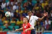 Granit Xhaka of Switzerland and Patrice Evra of France go up for a header during the 2014 FIFA World Cup Brazil Group E match between Switzerland and France at Arena Fonte Nova on June 20, 2014 in Salvador, Brazil.