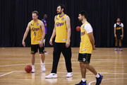 Andrew Bogut (C) looks on next to team mates Brad Newley (L) and Kevin Lisch (R) during a Sydney Kings NBL training session at Qudos Bank Arena on July 30, 2018 in Sydney, Australia.