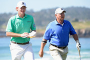 Brandt Snedeker and Toby Wilt on the tenth green during the final round of the AT&T Pebble Beach National Pro-Am at the Pebble Beach Golf Links on February 15, 2015 in Pebble Beach, California.
