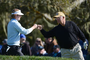Brandt Snedeker (L) celebrates his eagle on the second hole with his playing partner Toby Wilt during the final round of the AT&T Pebble Beach National Pro-Am at Pebble Beach Golf Links on February 10, 2013 in Pebble Beach, California.