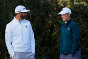 Dustin Johnson of the United States and Jordan Spieth of the United States talk during the first round of the AT&T Pebble Beach Pro-Am at Monterey Peninsula Country Club Shore Course on February 07, 2019 in Pebble Beach, California.