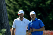 Dustin Johnson (L) and Jordan Spieth meet at the 17th tee during Round Two of the AT&T Pebble Beach Pro-Am at Monterey Peninsula Country Club on February 9, 2018 in Pebble Beach, California.