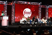 (L-R) President Of HGTV and Food Network, Allison Page, Judges Amanda Freitag, Marcus Samuelsson, Alex Guarnaschelli, Marc Murphy, Maneet Chauhan and Chris Santos of 'Chopped' speak onstage during the Food Network portion of the Discovery Communications Summer TCA Event 2018 at The Beverly Hilton Hotel on July 26, 2018 in Beverly Hills, California.
