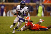 Ed Wesley #34 of the TCU Horned Frogs gets away from Da'Quan Bowers #93 of the Clemson Tigers during their game at Memorial Stadium on September 26, 2009 in Clemson, South Carolina.