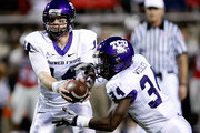 Quarterback Andy Dalton #14 of the Texas Christian University Horned Frogs hands the ball off to Ed Wesley #34 during their game against the UNLV Rebels at Sam Boyd Stadium October 30, 2010 in Las Vegas, Nevada. TCU won 48-6.