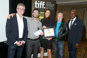 "(L-R) TIFF Director and CEO Piers Handling, Executives Noah Segal and Laurie May accept the Grolsch People's Choice Award Winner on behalf of ""The Imitation Game"", TIFF Festival Founder William Marshall and TIFF Artistic Director Cameron Bailey attend the TIFF Awards Brunch during the 2014 Toronto International Film Festival at Intercontinental Hotel on September 14, 2014 in Toronto, Canada."