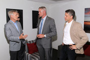 (L-R) Secretary of the Navy Ray Mabus, actor Eric Dane and executive producer Steven Kane talk backstage at the TNT 'The Last Ship' Washington D.C. Screening at The Newseum on June 12, 2015 in Washington, DC.