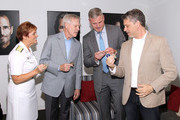 (L ro R) Admiral Dawn Cutler, Secretary of the Navy Ray Mabus, Actor Eric Dane and Executive producer Steven Kane exchange Challenge Coins backstage at the TNT 'The Last Ship' Washington D.C. Screening at The Newseum on June 12, 2015 in Washington, DC.