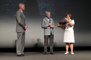 The Secretary of the Navy Ray Mabus (C) and Admiral Dawn Cutler present actor Eric Dane with a Shadow Box containing Navy medals earned by his father at the TNT 'The Last Ship' Washington D.C. Screening at The Newseum on June 12, 2015 in Washington, DC.
