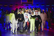 Naomi Campbell, Lewis Hamilton, H.E.R and Tommy Hilfiger (R) walk the runway at TOMMYNOW London Spring 2020 at Tate Modern on February 16, 2020 in London, England.