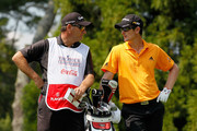Justin Rose of England (R) talks with his caddie Mark Fulcher (L) on the second tee during the first round of THE TOUR Championship presented by Coca-Cola at East Lake Golf Club on September 23, 2010 in Atlanta, Georgia.