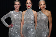 Models Karen Bjornson, Pat Cleveland and Alva Chinn pose backstage for TRESemme at the Naeem Khan show during NYFW on February 12, 2019 in New York City.